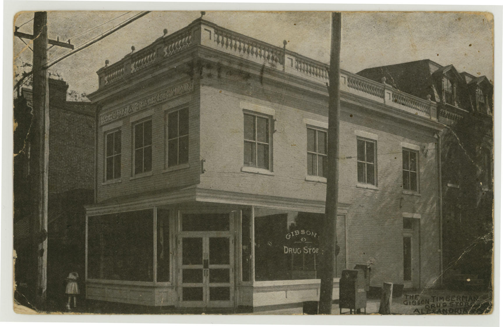 1909 postcard image of Gibson and Timberman's drug store
